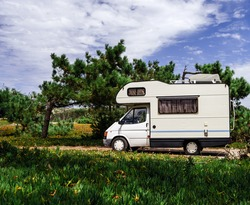 Touristic caravan staying in a forest. Comfort and freedom.