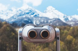 touristic telescope look at the city with view snow mountains, closeup binocular on background viewpoint observe vision, metal coin operated in panorama observation, travel nature concept