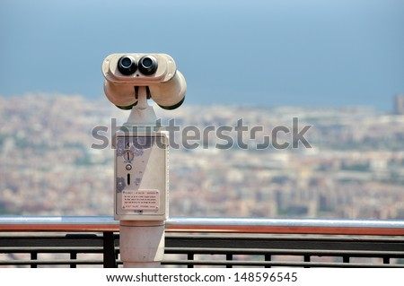 Touristic telescope with view of Barcelona, Spain from mountain