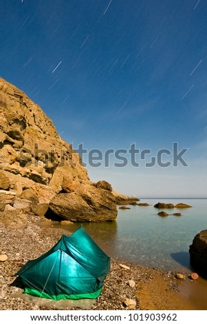 touristic tent on a sea coast at the night long exposure
