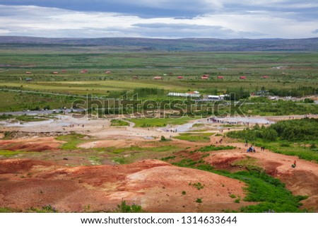 Tourists at Haukadalur geothermal valley waiting for the Great Geysir or Strokkur geysir to erupt. Geysir is one of the most popular tourist destinations on Golden Circle Tourist Route in Iceland
