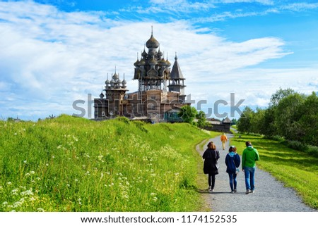 Tourists at Kizhi Pogost with Transfiguration Church on Ladoga Lake in Karelia, of Russia