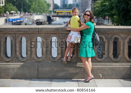 Tourists. Beautiful mother and daughter walking in berlin city.