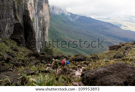 Tourists descend from the plateau Roraima in a very difficult path - Venezuela, South America