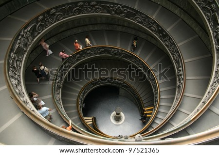 Tourists descending by the spiral staircase of the Vatican Museums, Vatican City.