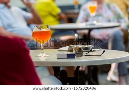 Tourists drinks beer in street cafe, Europe #1572820486