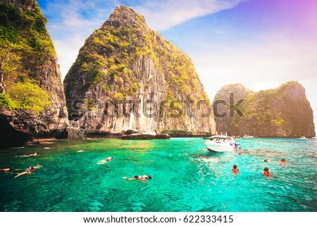 Tourists enjoy with snorkeling in a tropical sea at Maya bay Phi Phi Islands Andaman in Krabi, Thailand