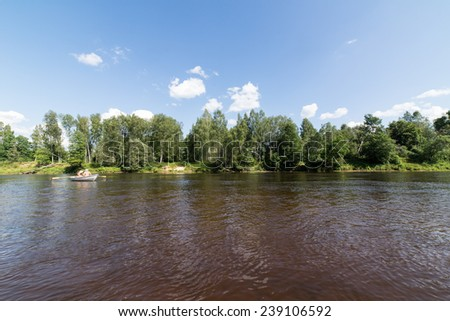 tourists enjoying water sports, kayaking in wild river - Sigulda, Latvia, 2014-07-27