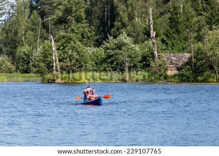 tourists enjoying water sports, kayaking in wild river - Sigulda, Latvia, 2014-07-27