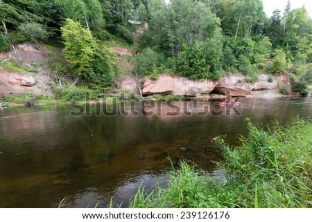 tourists enjoying water sports, kayaking in wild river - Sigulda, Latvia
