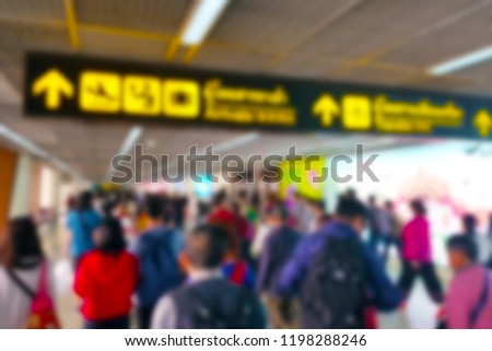 Tourists from airplanes are walking to the immigration gates in Don Muang International Airport, with blurred defocused effect. #1198288246
