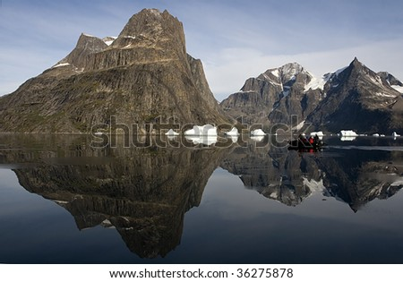 Tourists in a Zodiak cruising through Sermilik Fjord, Greenland