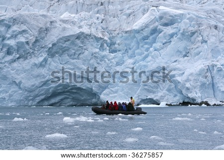 Tourists in front of a glacier in Napassorsuaq Fjord, Greenland