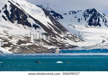 Tourists in inflatable ocean kayaks in the Arctic Ocean, Hornsund, Norway