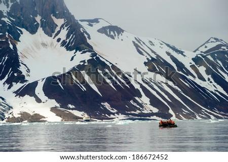 Tourists in inflatable ocean rafts in the Arctic Ocean, Hornsund, Norway