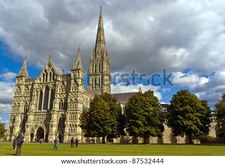 Tourists in the grounds of Salisbury Cathedral, Wiltshire