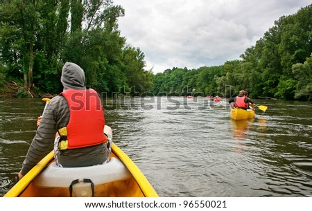 Tourists kayaking on river Dordogne in southern France