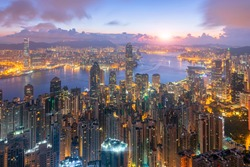 Tourists look from the Victoria Peak at sunrise and Twilight. Night of hong kong city Will see the financial office, beautiful lights. or sunset time skyline view to hong kong city and sea and Kowloon
