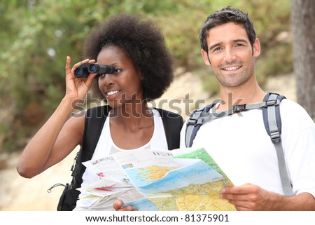 tourists looking a map and using binoculars