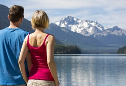Tourists looking at Duffey Lake in Duffey Lake Provincial Park, BC, Canada