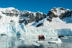 Tourists observing a glacier on the Antarctica, Paradise bay, Antartica.