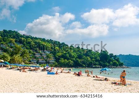 Tourists on the Kata Noi beach - one of the best beaches in Phuket, Thailand