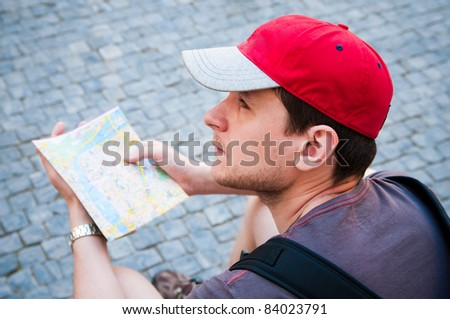 Tourists on the street looking at a guide