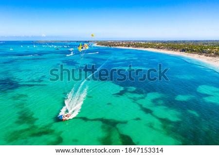 Tourists parasailing near Bavaro Beach, Punta Cana in Dominican Republic. Aerial view of tropical resort Foto d'archivio ©