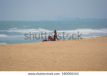 Tourists relax on the beach in Cha-am district Thailand  2/15/2017 #580006561