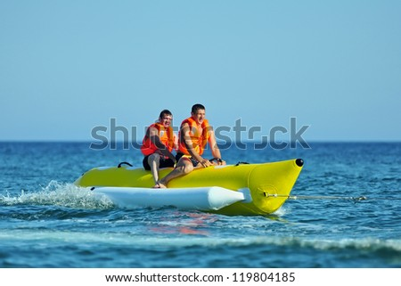 Tourists ride a Banana Boat