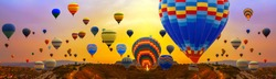 Tourists ride hot air ballons during a mass ascension at the International Balloon Festival panorama