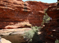Tourists sitting and swimming at Garden of Eden Waterhole in Kings Canyon outback central Australia