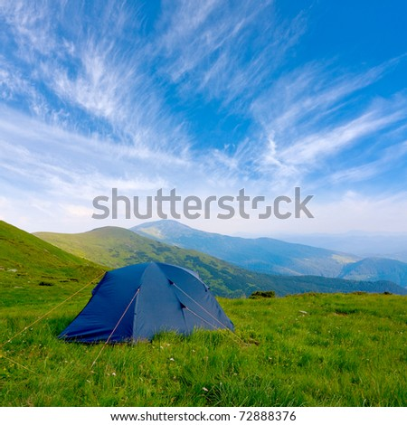 Tourists tent in mountain in nice day #72888376
