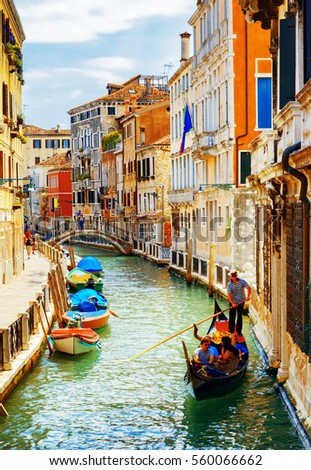 Tourists traveling in gondola. View of the Rio Marin Canal with boats from the Ponte de la Bergami in Venice, Italy. Venice is a popular tourist destination of Europe. #560066662