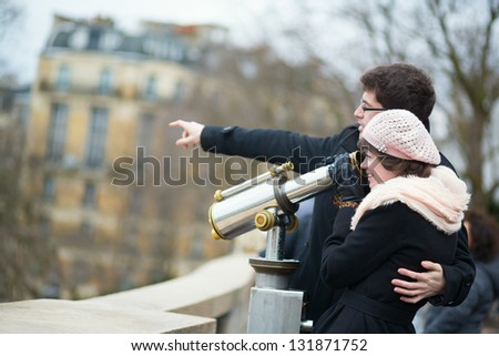 Tourists using telescope for sightseeing