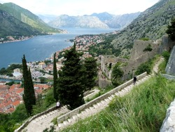 Tourists visit Fortifications of Kotor in Kotor, Montenegro. Fortifications of Kotor are an integrated historical fortification system protected the medieval town of Kotor.