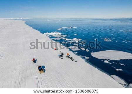 Tourists visit the flo edge near Sirmilik National Park in Nunavut, Canada #1538688875