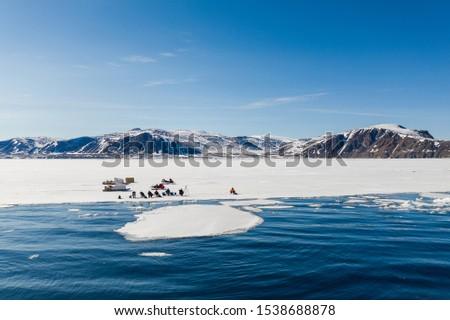 Tourists visit the flo edge near Sirmilik National Park in Nunavut, Canada #1538688878