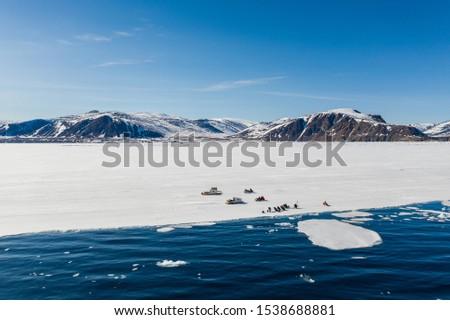 Tourists visit the flo edge near Sirmilik National Park in Nunavut, Canada #1538688881