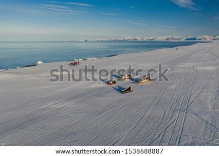 Tourists visit the flo edge near Sirmilik National Park in Nunavut, Canada #1538688887