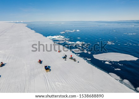 Tourists visit the flo edge near Sirmilik National Park in Nunavut, Canada #1538688890