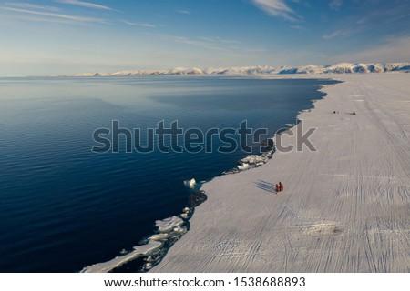 Tourists visit the flo edge near Sirmilik National Park in Nunavut, Canada #1538688893