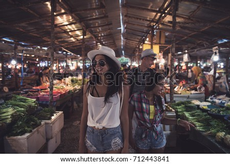 Tourists Walking Between Rows On Tropical Exotic Market Young People Choosing Fresh Fruits And Vegetables In Asian Traditional Bazaar #712443841
