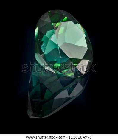 tourmaline gem stone isolated on black background. #1118104997