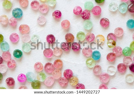 Tourmaline. Natural stone multi-colored tourmaline. Green, yellow, orange, pink, blue tourmaline. Colorful natural background from stones. Copy space for your text.
