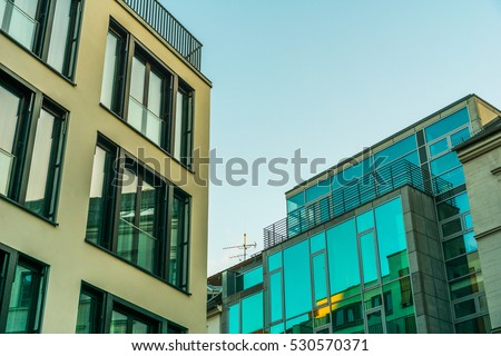 tow big office buildings with glass facade