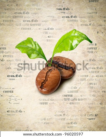 Tow coffee beans with green leaves on a background of aged paper with the word coffee repeated multiple times in different languages