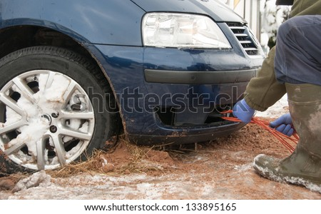 Tow rope being attached to the car towing eyelet