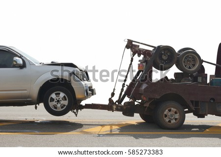 Tow truck delivers the damaged vehicle  isolated on white background, with clipping path