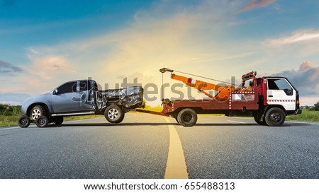 Tow truck delivers the damaged vehicle, Sun light flare, Selective focus